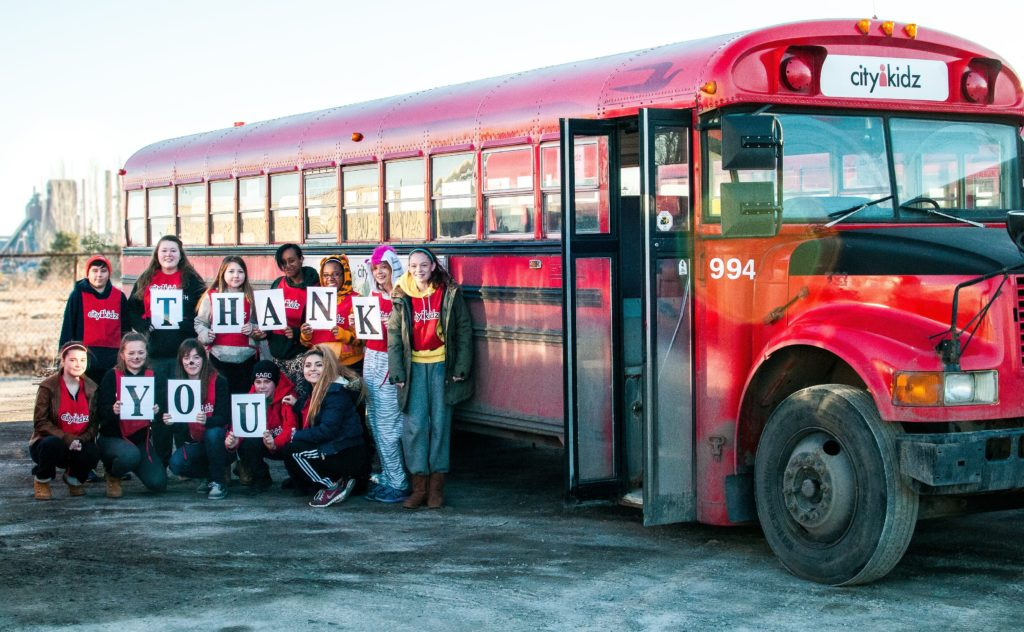 Here Comes the Big Red Bus!  HPA Supports CityKidz Transportation Program with $5000 Donation